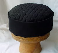 Black smoking cap showing the quilted tip
