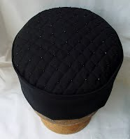 The tip of the smoking cap is quilted and beaded with black seed beads
