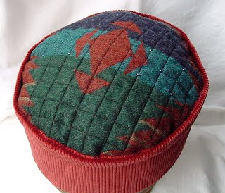 The Aztec design on this hippie style hat has been highlighted with seed beads