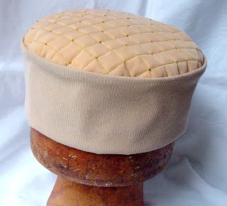 Quilted and beaded smoking cap in sand, taupe and gold